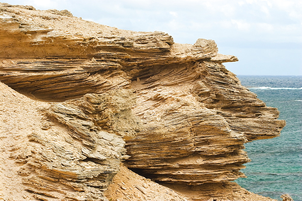 Limestone outcrop showing classic cross bedding created by ancient dune sands, at Hamelin Bay on the coast north of Cape Leeuwin at the south western tip of Australia, Augusta-Margaret River Shire, Western Australia, Australia, Pacific