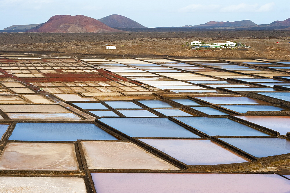 The only salt pans on the island still being worked, at Salinas de Janubio in the south, Salinas de Janubio, Teguise, Lanzarote, Canary Islands, Spain, Atlantic, Europe - 83-12396