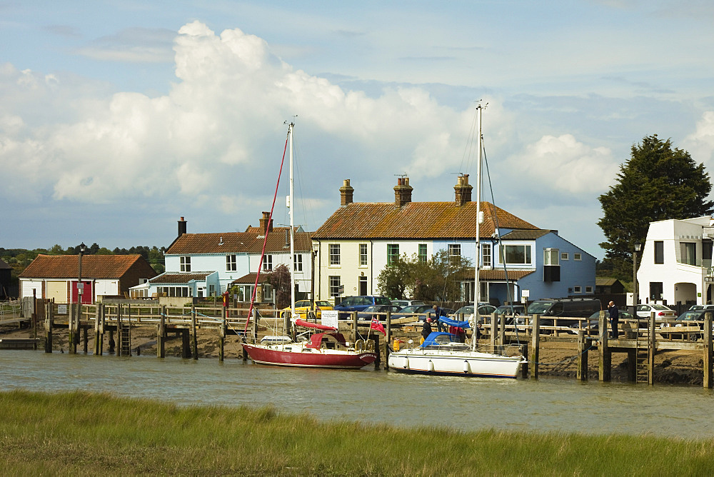 Looking across River Blyth towards houses and moored yachts on the Southwold bank, Walberswick, Suffolk, England, United Kingdom, Europe