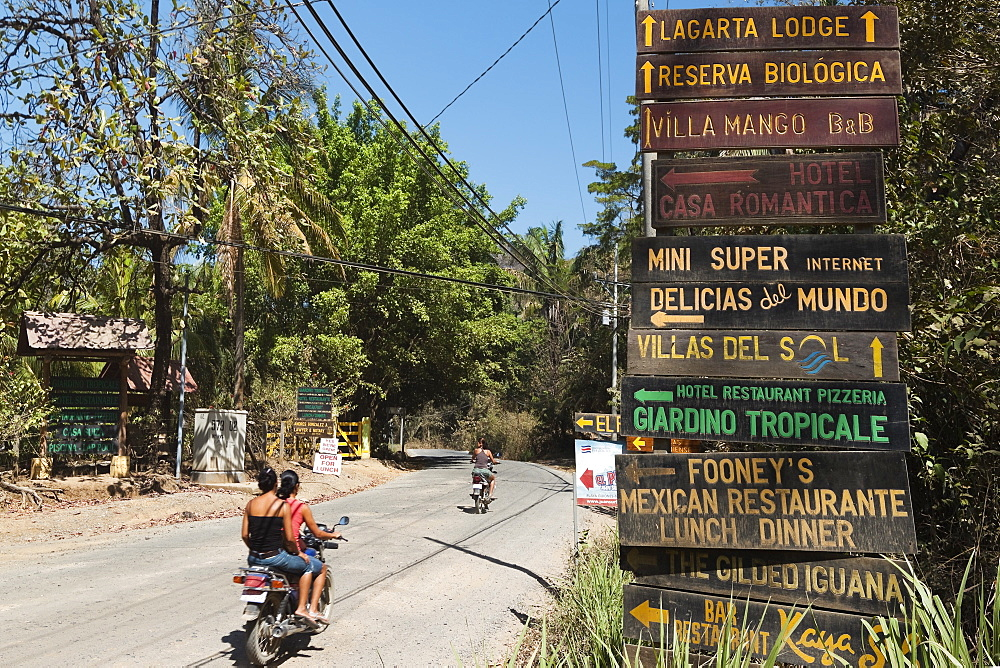 Signs for tourists near popular Playa Guiones beach, Nosara, Nicoya Peninsula, Guanacaste Province, Costa Rica, Central America