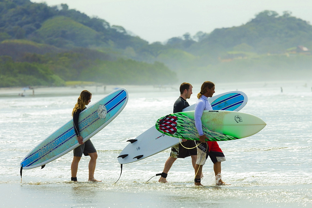 Couple going for surf lesson at Playa Guiones beach, Nosara, Nicoya Peninsula, Guanacaste Province, Costa Rica, Central America