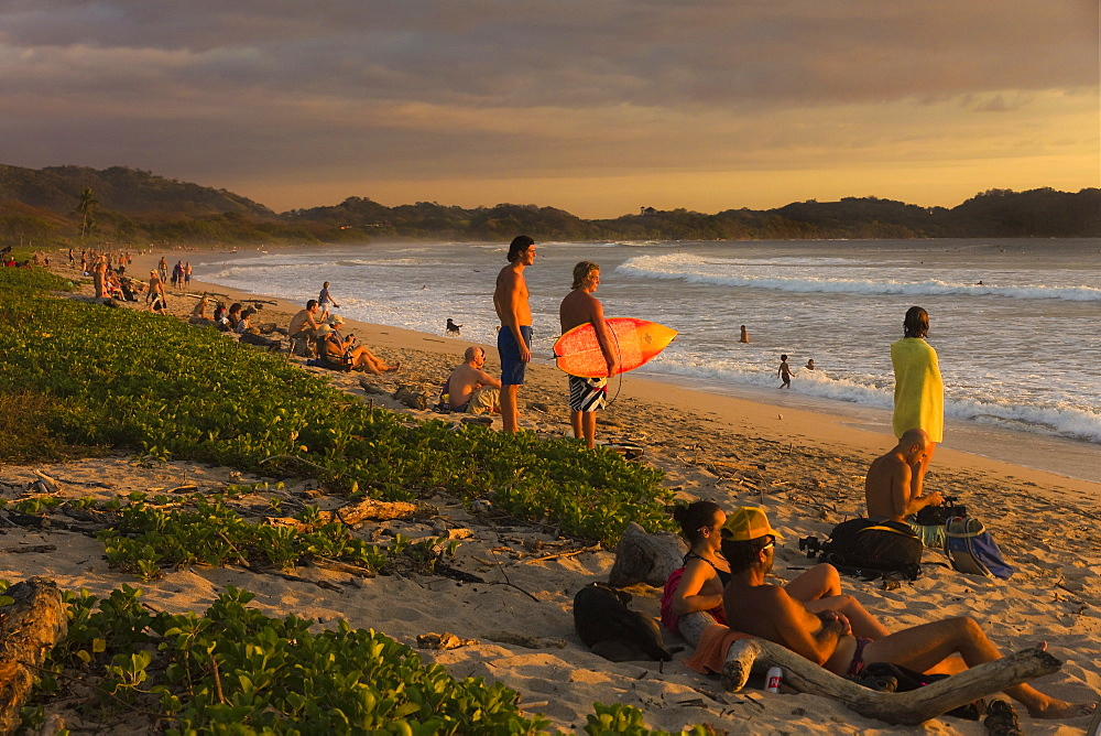 Traditional sunset gathering on Playa Guiones beach, Nosara, Nicoya Peninsula, Guanacaste Province, Costa Rica, Central America - 83-12629