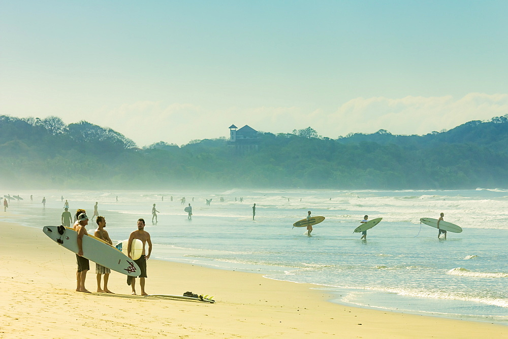 Surfers on Playa Guiones beach, Nosara, Nicoya Peninsula, Guanacaste Province, Costa Rica, Central America