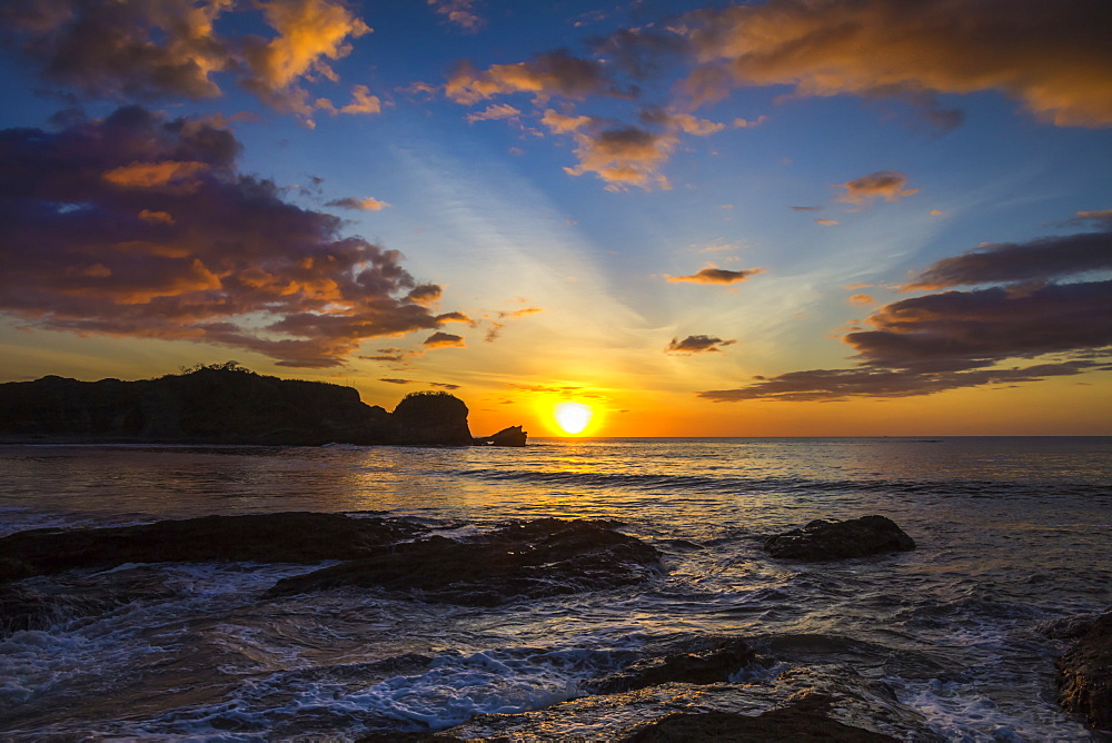 Sunset by the southern headland of beautiful Playa Pelada beach, Nosara, Nicoya Peninsula, Guanacaste Province, Costa Rica