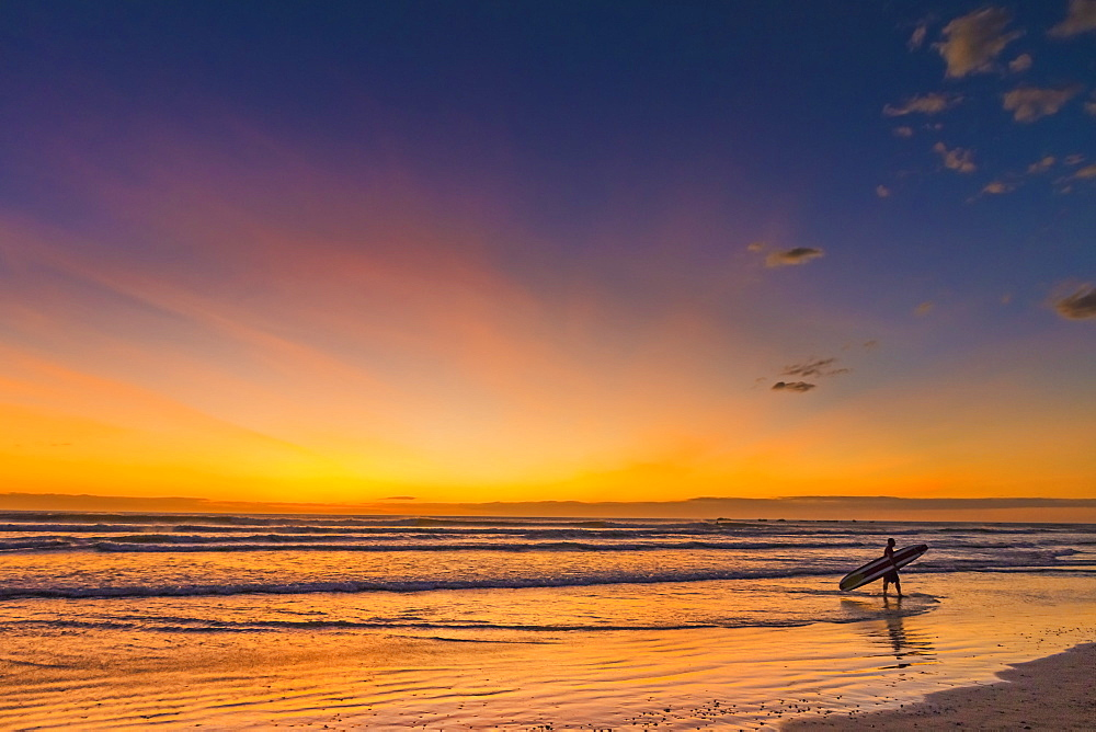 Sunset & surfer at Playa Guiones beach, Nosara, Nicoya Peninsula, Guanacaste Province, Costa Rica, Central America - 83-12639