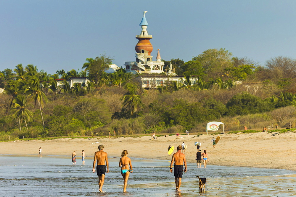 Walkers & the Nosara Beach Hotel at popular Playa Guiones beach, Nosara, Nicoya Peninsula, Guanacaste Province, Costa Rica, Central America