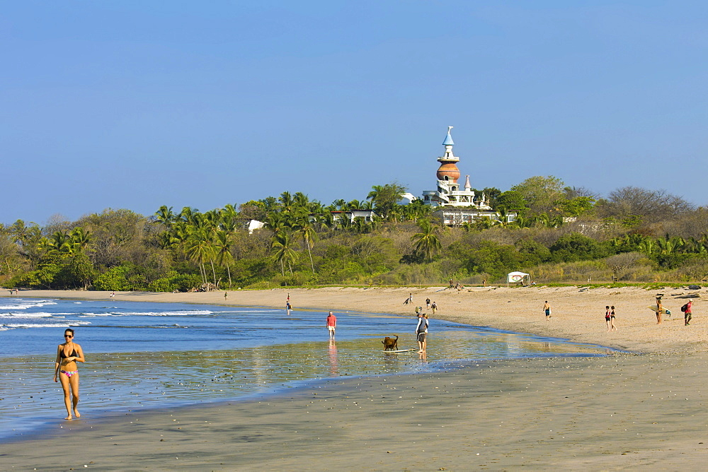 Walkers and the Nosara Beach Hotel at popular Playa Guiones beach, Nosara, Nicoya Peninsula, Guanacaste Province, Costa Rica, Central America