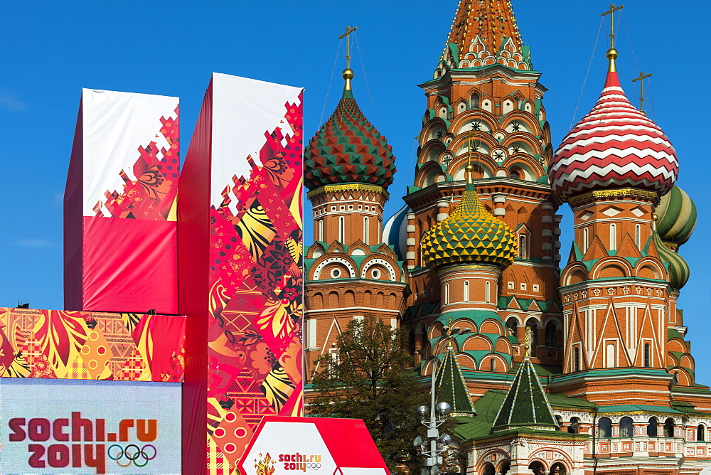 Torch Relay stand for Sochi Winter Olympics 2014, with onion domes of St. Basil's Cathedral beyond, Red Square, Moscow, Russia, Europe