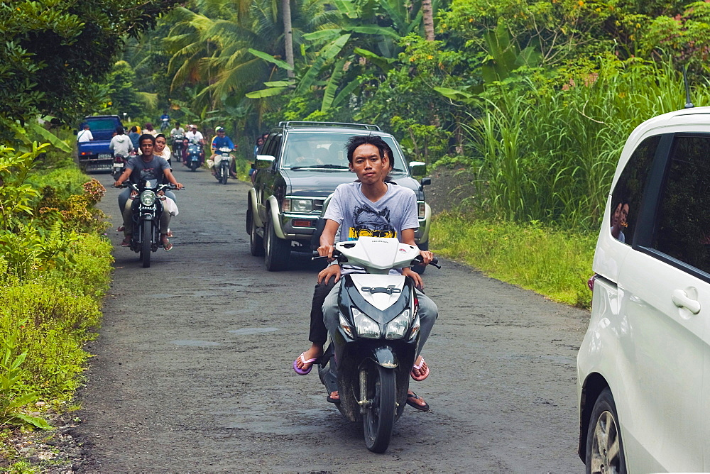 Busy traffic, typical of Java's now clogged roads, near the south coast resort town of Pangandaran, West Java, Java, Indonesia, Southeast Asia, Asia