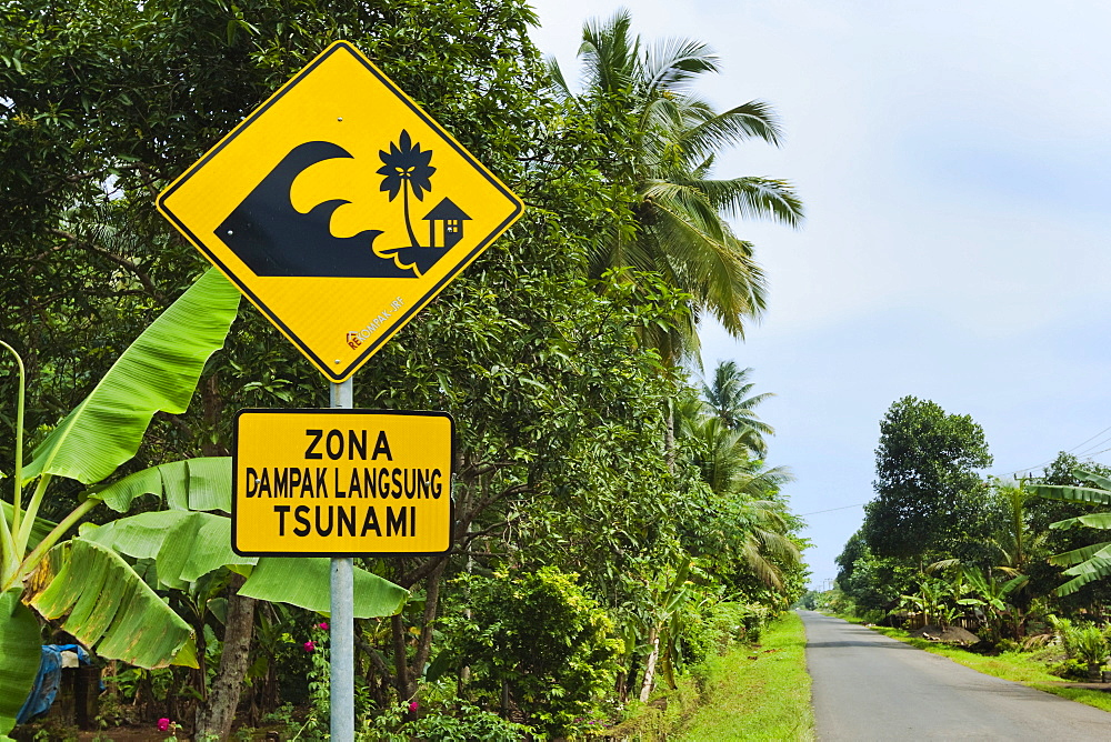 Tsunami zone warning sign on the south coast road near Cikalong, West Java, Java, Indonesia, Southeast Asia, Asia