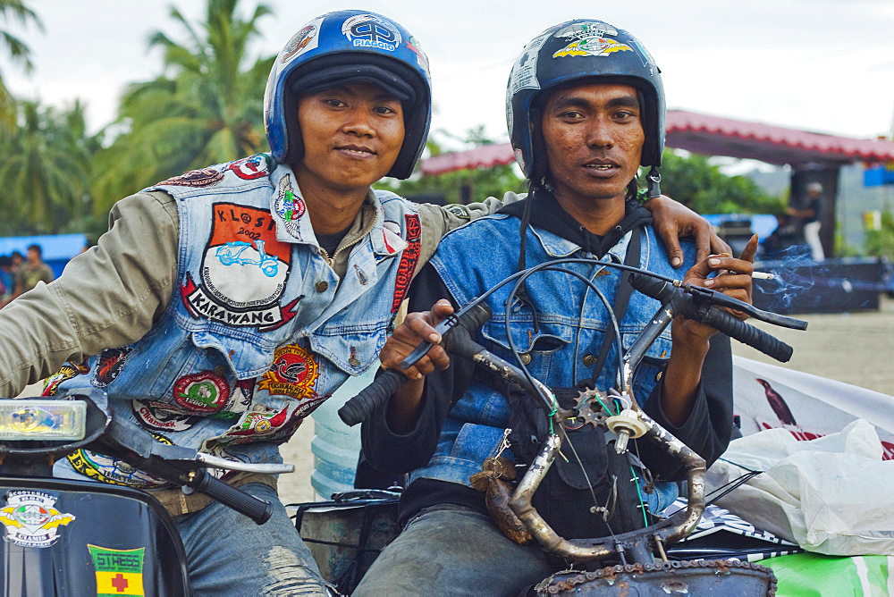 Young men in helmets at a scooter enthusiasts' meet in this major south coast resort, Pangandaran, West Java, Java, Indonesia, Southeast Asia, Asia
