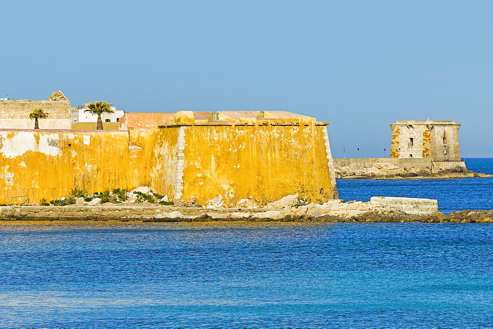 Old city walls and Tower of Ligny dating from 1671, now a Museum of Prehistory, on sea front of this northwest fishing port, Trapani, Sicily, Italy, Mediterranean, Europe