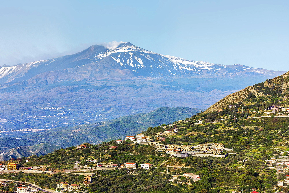 Looking from Taormina towards Trupiano and the smoking 3350m high volcano of Mount Etna during an active phase, Trupiano, Sicily, Italy, Mediterranean, Europe