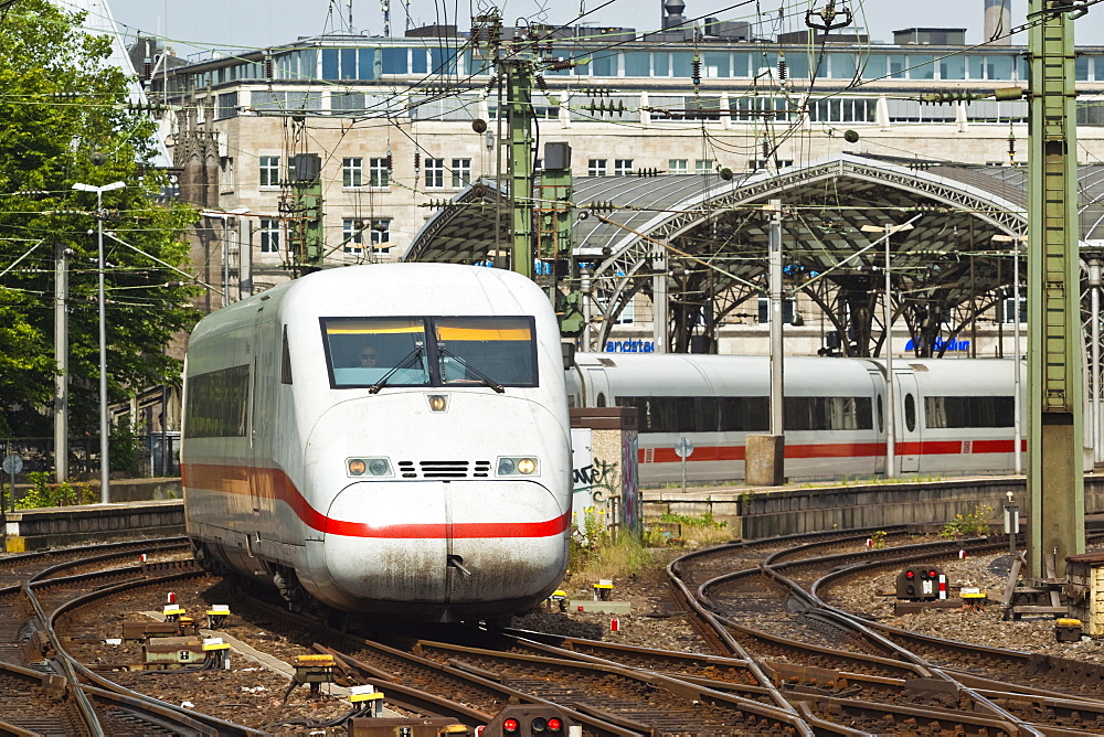 Intercity-Express ICE electric train leaving the central Hauptbanhof (railway station), Cologne, North Rhine-Westphalia, Germany, Europe