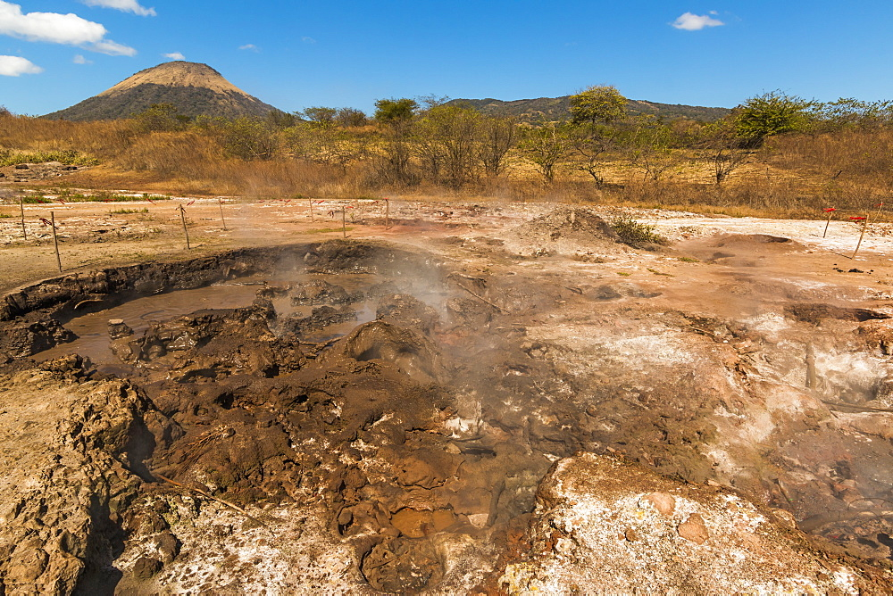 Mud pots, fumaroles and dormant Volcan Santa Clara at the San Jacinto volcanic thermal area north of Leon, Leon, Nicaragua, Central America