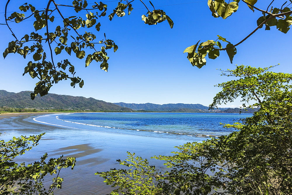 View from Tambor across Ballena Bay towards Pochote on the southern tip of the Nicoya Peninsula, Tambor, Puntarenas, Costa Rica, Central America