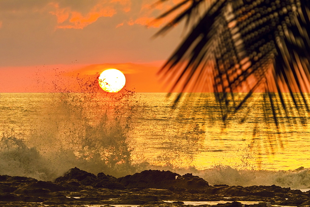 Sun going down behind surf spray at this resort near Mal Pais, southern Nicoya Peninsula, Santa Teresa, Puntarenas, Costa Rica, Central America