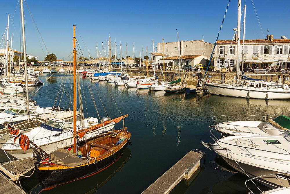 Yachts moored at the Quai de Bernonville in this north coast town. Saint Martin de Ré, Ile de Ré, Charente-Maritime, France