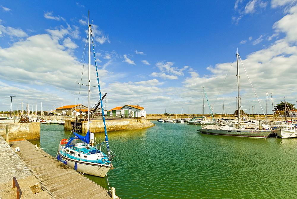 Yacht at marina by Quai de La Criee in the island's principal western town: Ars en Ré, Ile de Ré, Charente-Maritime, France