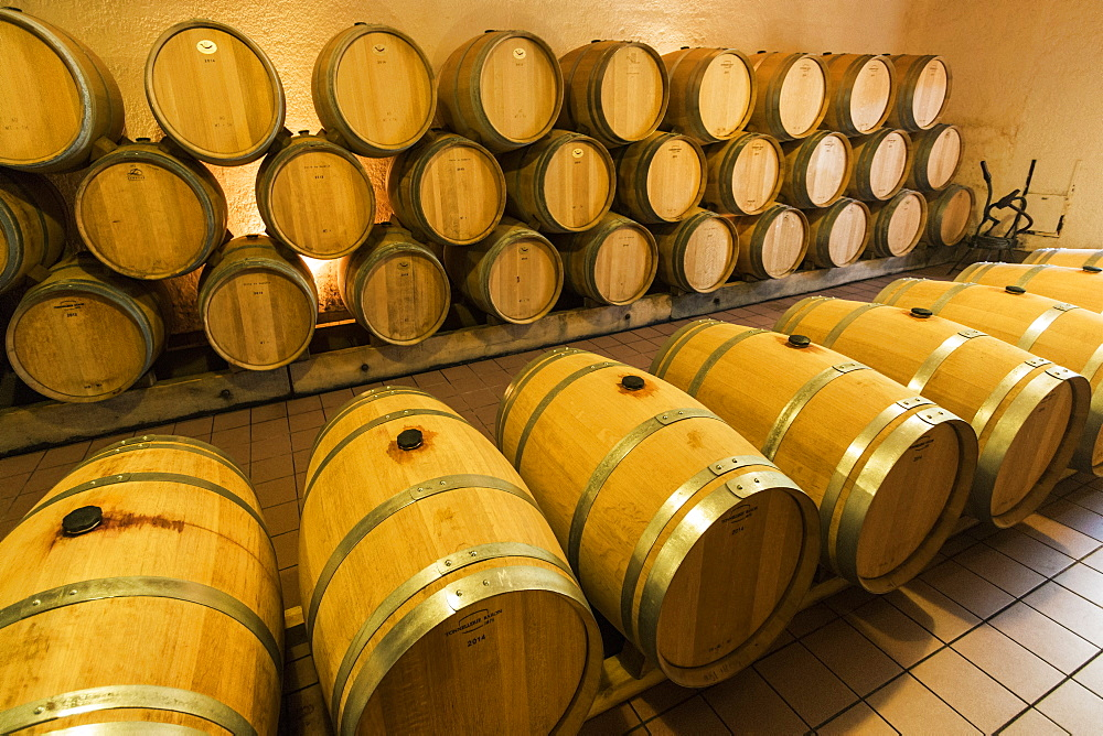 Grand Cru wine barrels at Château Cantenac near this old town & famous Bordeaux red wine region. Saint Émilion, Gironde; France