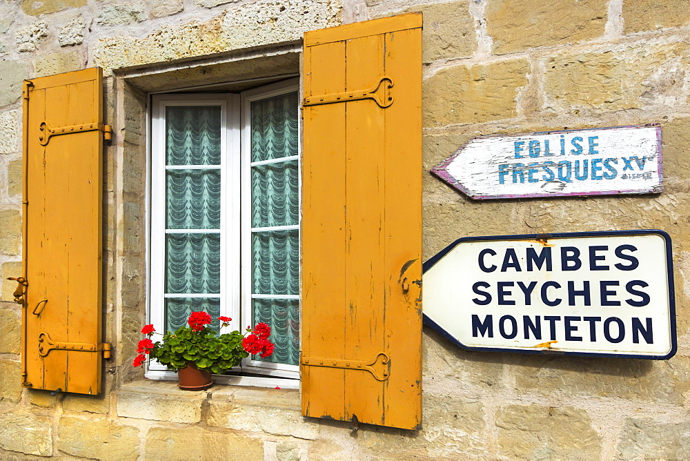 Shuttered window and signs in this old village on the Dropt River near Duras, Lot-et-Garonne, Aquitaine, France, Europe