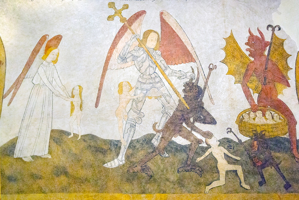 The 15 century Last Judgement fresco in St. Eutrope church in this historic Dropt Valley village, Allemans-du-Dropt, Lot-et-Garonne, France, Europe - 83-13000