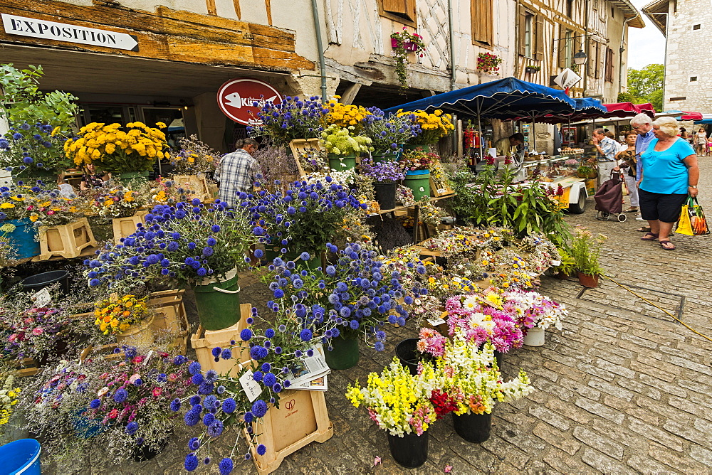 Flower stall in Place Gambetta on popular market day at this south west historic bastide town. Eymet; Bergerac; Dordogne; France