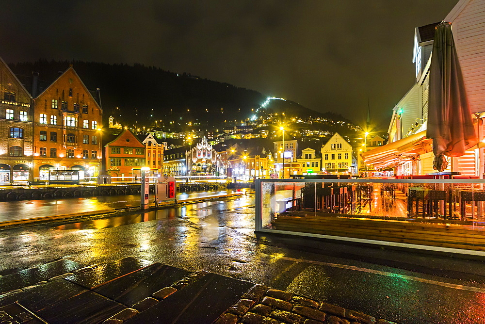 The Fjord Restaurant by Vagen Harbour with the Bryggen waterfront and funicular rail beyond, at night, Bergen, Hordaland, Norway, Scandinavia, Europe - 83-13048