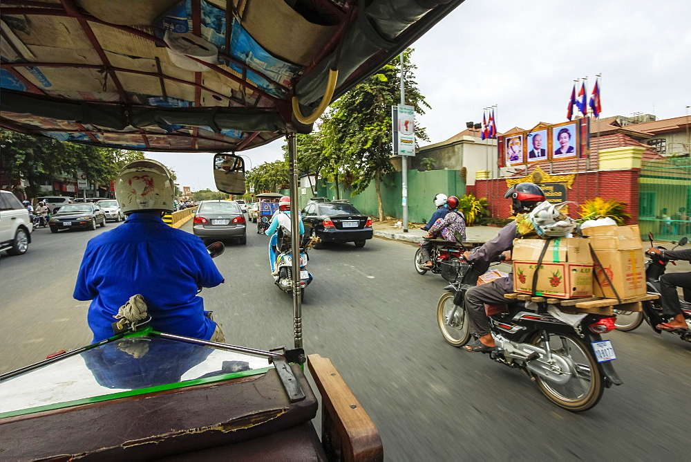 Passenger view from moving remork-moto (motorcycle and carriage), typical cheap transport here, City centre, Phnom Penh, Cambodia, Indochina, Southeast Asia, Asia