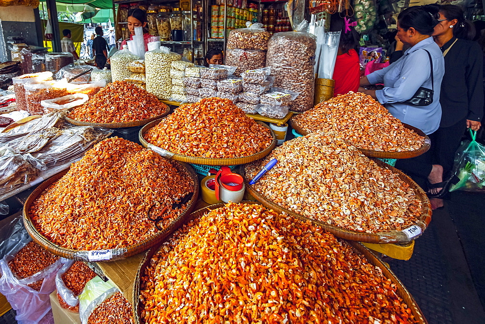 Piles of dried shrimp for sale at stall in this huge old market, Central Market, city centre, Phnom Penh, Cambodia, Indochina, Southeast Asia, Asia