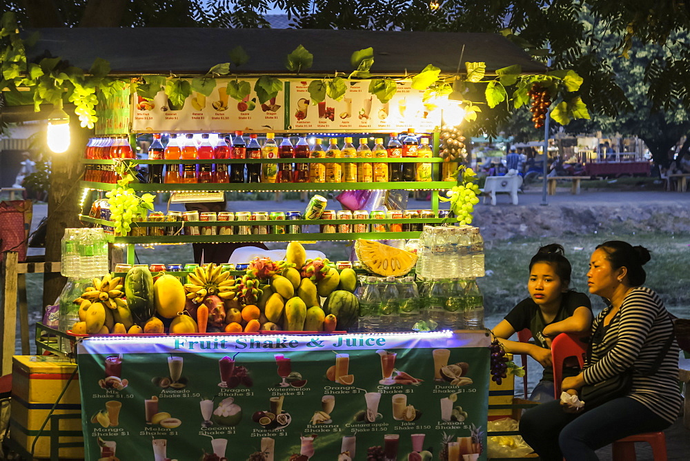 Fruit & drink stall at the Art Center Night Market by the Siem Reap River in this north west tourist town; Siem Reap, Cambodia