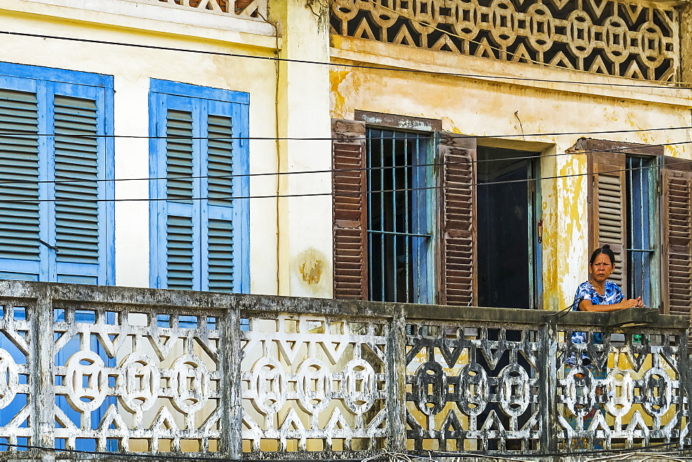 Faded balconies and shutters on a street in this old formerly French colonial river port, Kampot, Kampot Province, Cambodia, Indochina, Southeast Asia, Asia