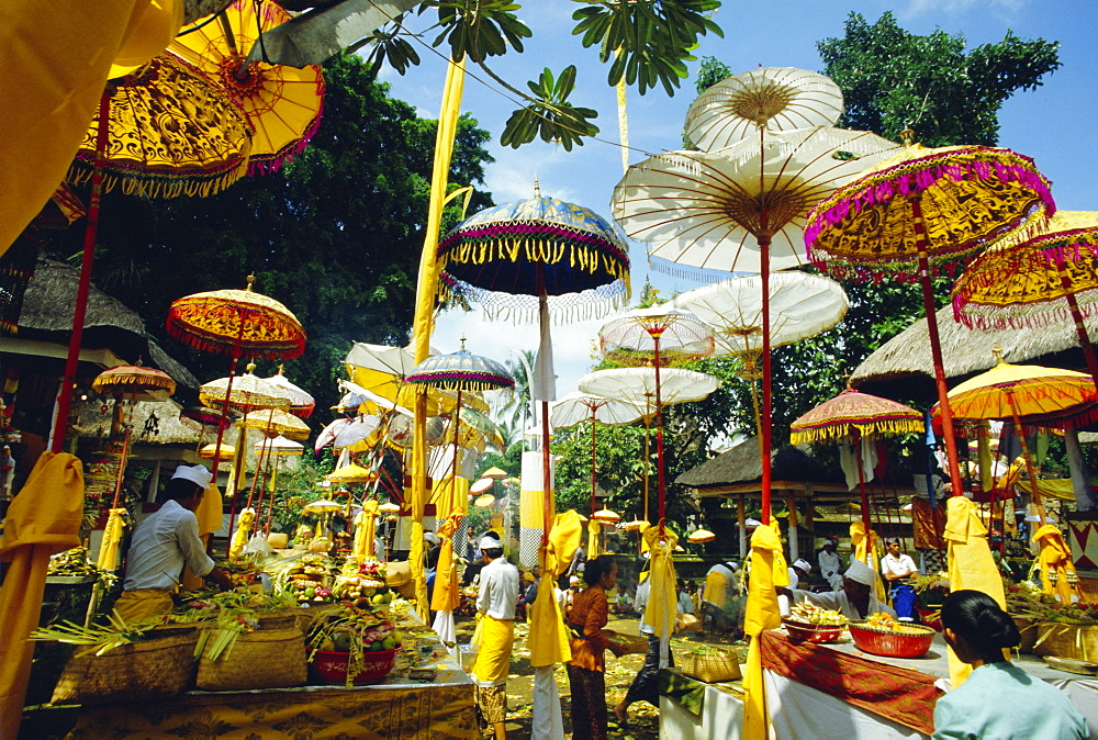 Parasols in Pura Taman Pule Hindu temple on Koningan Day, Bali's second most important holiday when the holy souls of the ancestors are revered, Gianyar district, Bali, Indonesia