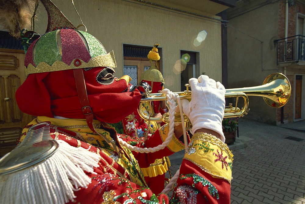 Trumpet player in red costume and mask celebrates the Feast of the Jews, just before Easter, in the Lombard village of San Fratello, north Sicily, Italy, Europe - 83-5023