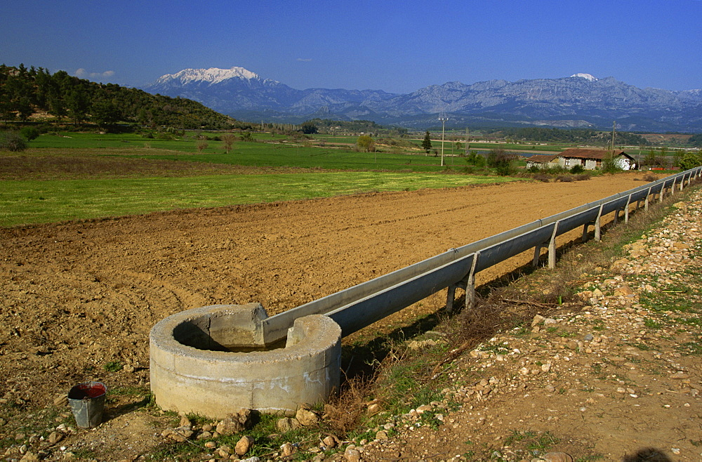 Irrigation channel in countryside near Kursunlu, with Kuyucak mountains in distance, Anatolia, Turkey, Asia Minor, Eurasia