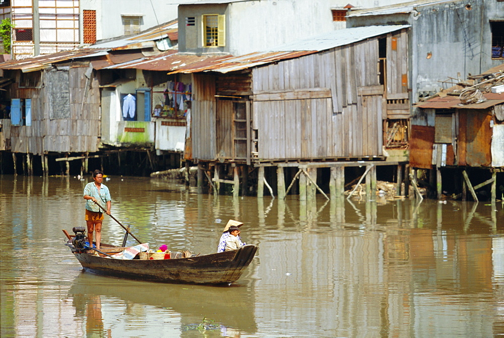 Boat on the Kinh Ben Nghe, a tributary of the Saigon River, Ho Chi Minh City, formerly Saigon, Vietnam, Asia