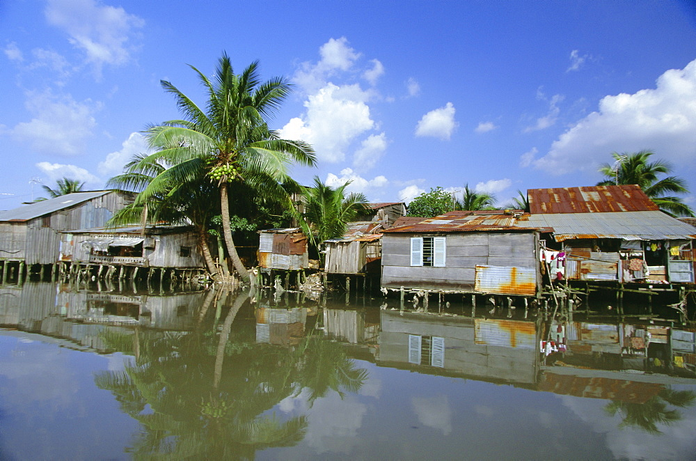 Houses on stilts on the Rach Thi Nghe, backwater of the Saigon River, Ho Chi Minh City (formerly Saigon), Vietnam, Indochina, Southeast Asia, Asia