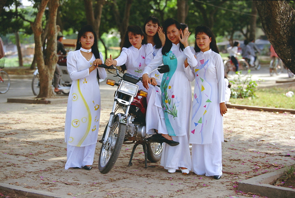 Group of college girls wearing traditional ao dai at West Lake (Hoy Tay) on graduation day, Hanoi, Vietnam, Indochina, Southeast Asia, Asia
