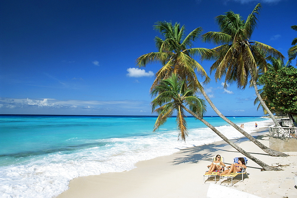 Sunbathers on Worthing Beach, on the south coast, Christ Church, Barbados, West Indies, Caribbean, Central America