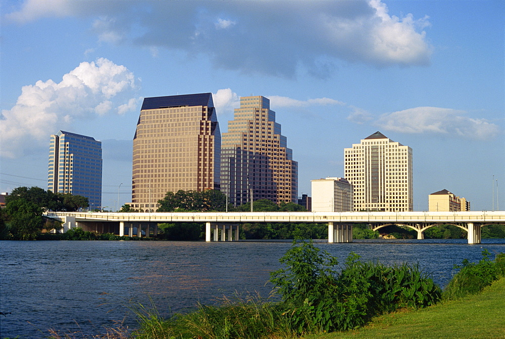 The river, bridge and skyline of downtown in the state capital, looking from Riverside, Austin, Texas, United States of America, North America