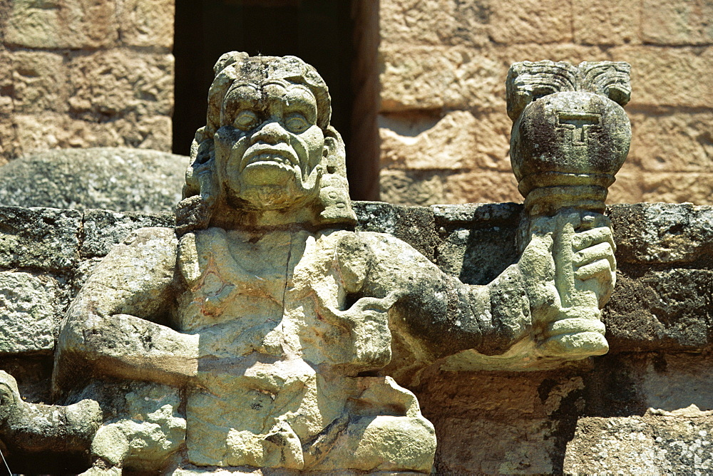 The Mayan rain god Chac, holding burning torch showing his power to withhold or dispense rain, in west court of the Mayan ruins at Copan, UNESCO World Heritage Site, western highlands, Honduras, Central America