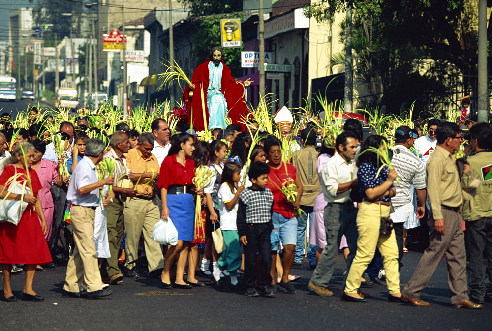 Crowds of people in the Palm Sunday procession in the centre of San Salvador, El Salvador, Central America