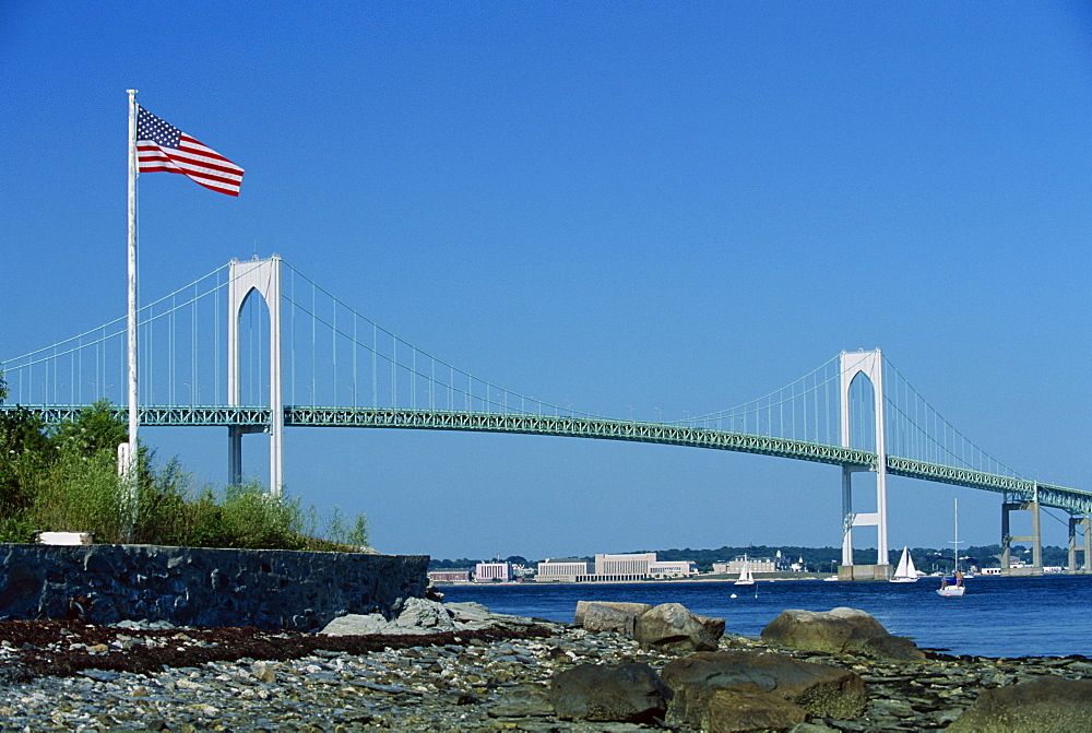 The Stars and Stripes flying before the Newport Bridge, connecting Jamestown, Conanicut Island, and Aquidneck Island, Rhode Island, New England, United States of America, North America