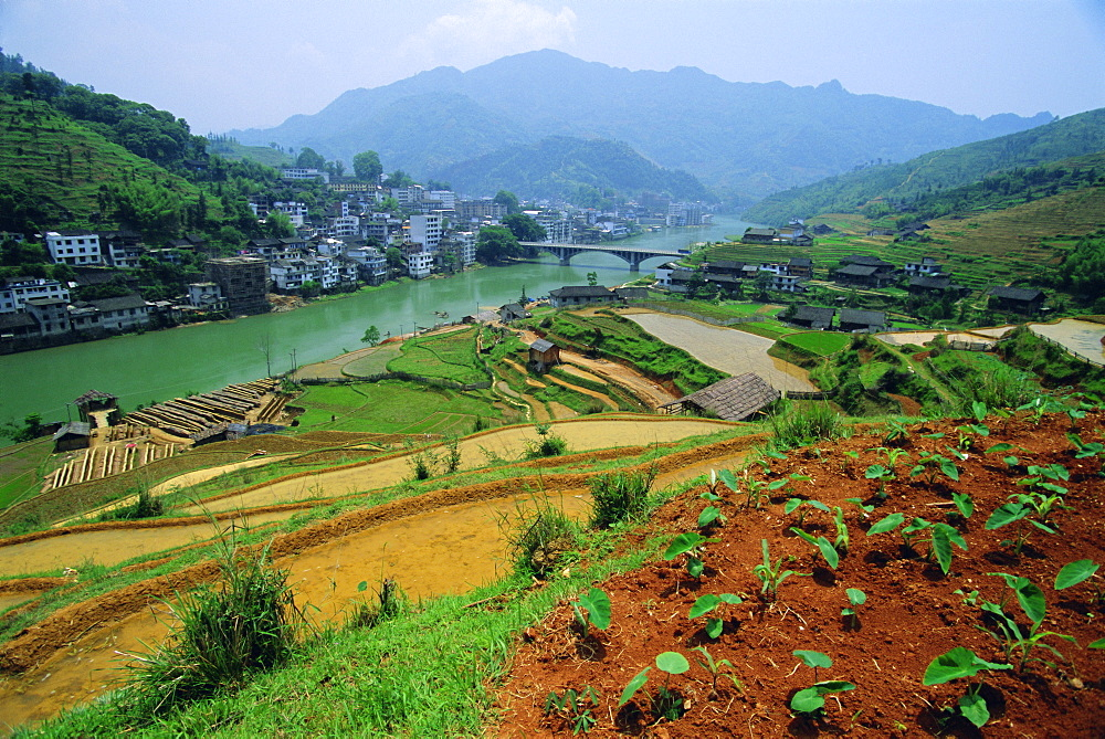 Rice paddies and brick-maker at Longsheng in northeast Guangxi Province, China
