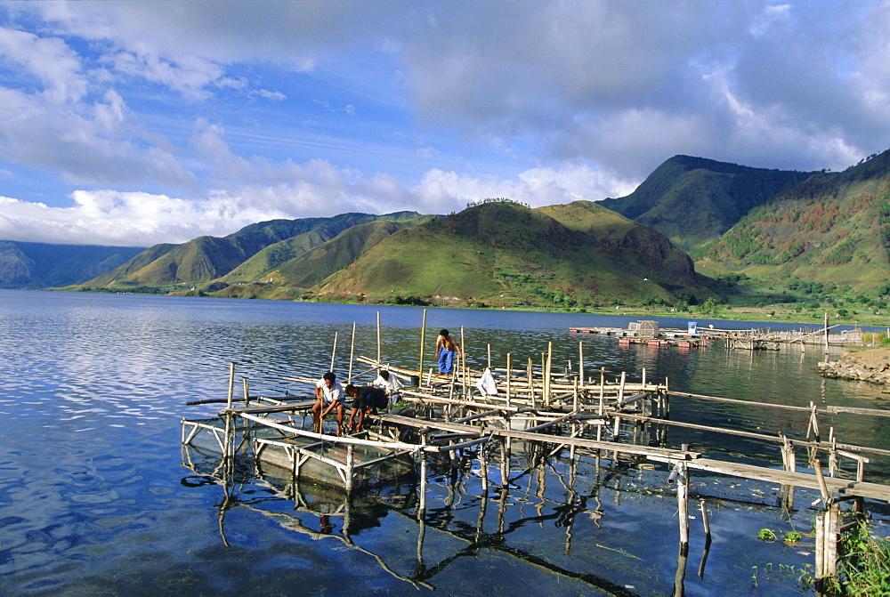 Fish rearing cages on northern tip of Lake Toba, the largest lake in SE Asia, Tongging, Lake Toba, Sumatra, Indonesia