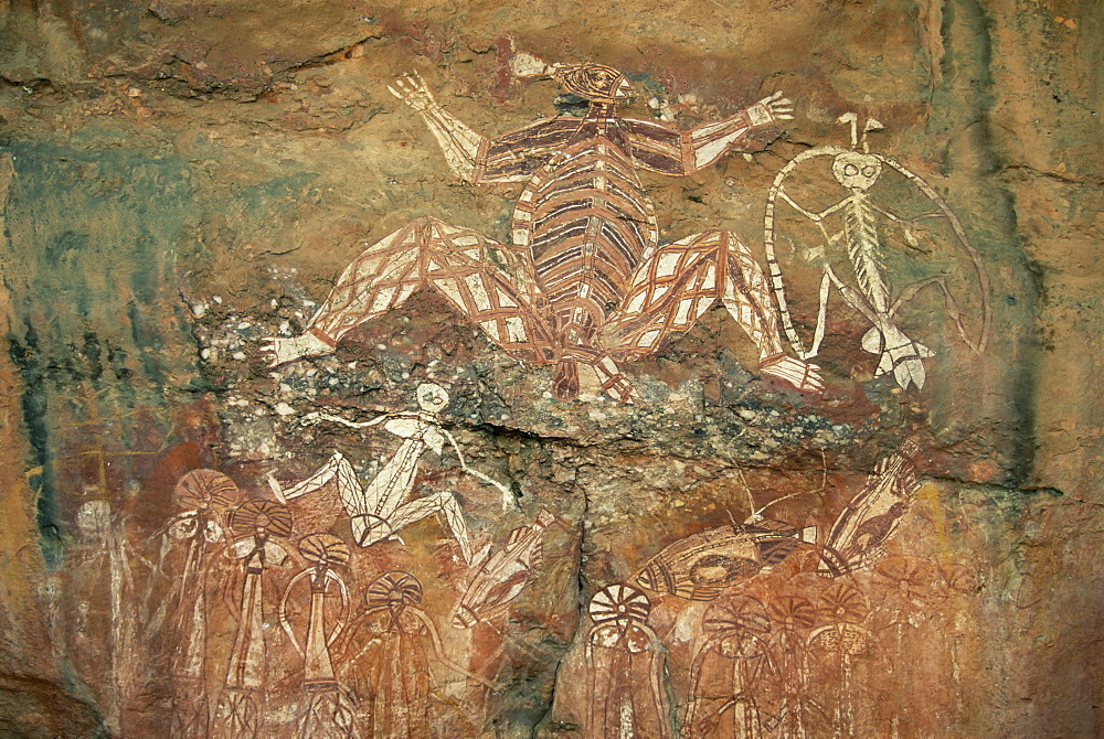 Namondjok in centre, who ate his clan sister, Namarrgon on right the Lightning Man and Barrginj his wife below left, supernatural ancestors at the rock art site, Nourlangie Rock, Kakadu National Park, UNESCO World Heritage site, Northern Territory, Australia, Pacific