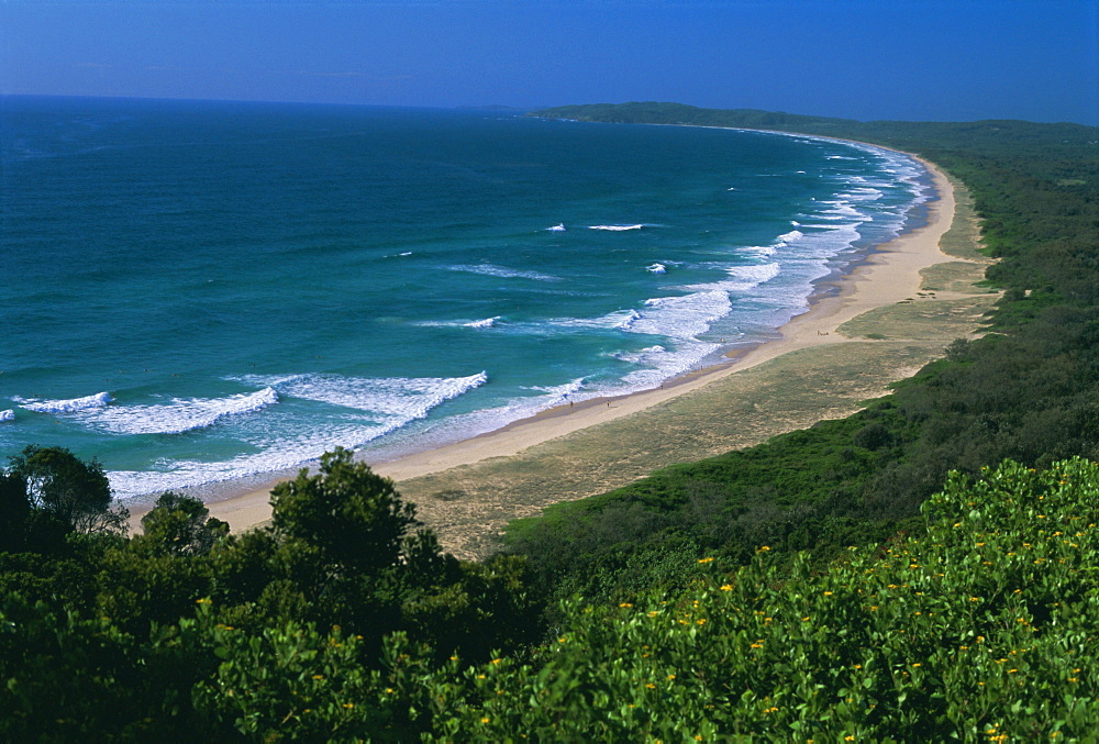 Looking south from Cape Byron to Tallow Beach, a surfing spot east of the resort of Byron Bay in the northeast of New South Wales, Australia