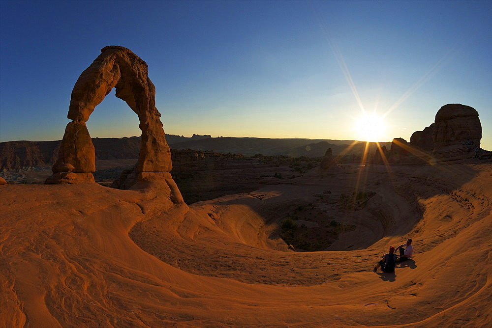 Two men sitting, Delicate Arch, Arches National Park, Moab, Utah, United States of America, North America