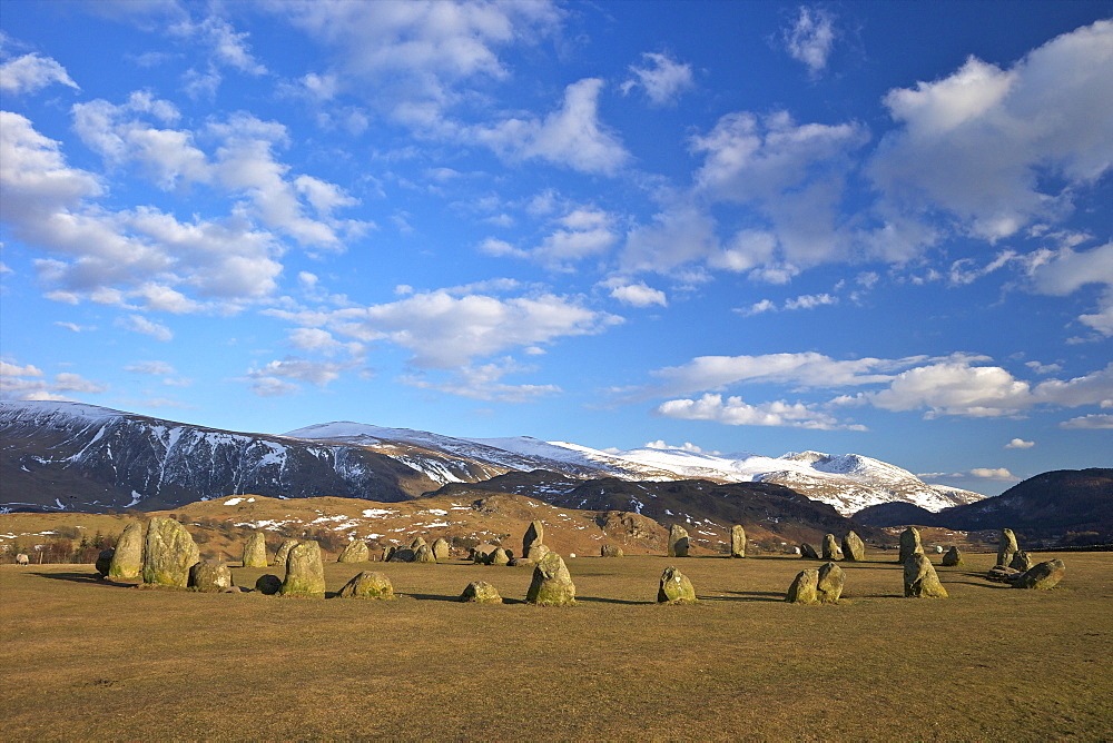 Castelrigg Megalithic Stone Circle in winter with Helvellyn range behind, Lake District National Park, Cumbria, England, United Kingdom, Europe