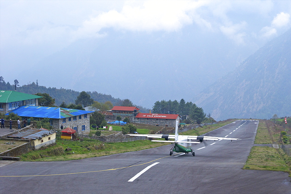 Tara Air DHC-6 Twin Otter plane taking off from runway, Tenzing-Hillary Airport, Lukla, Nepal, Asia